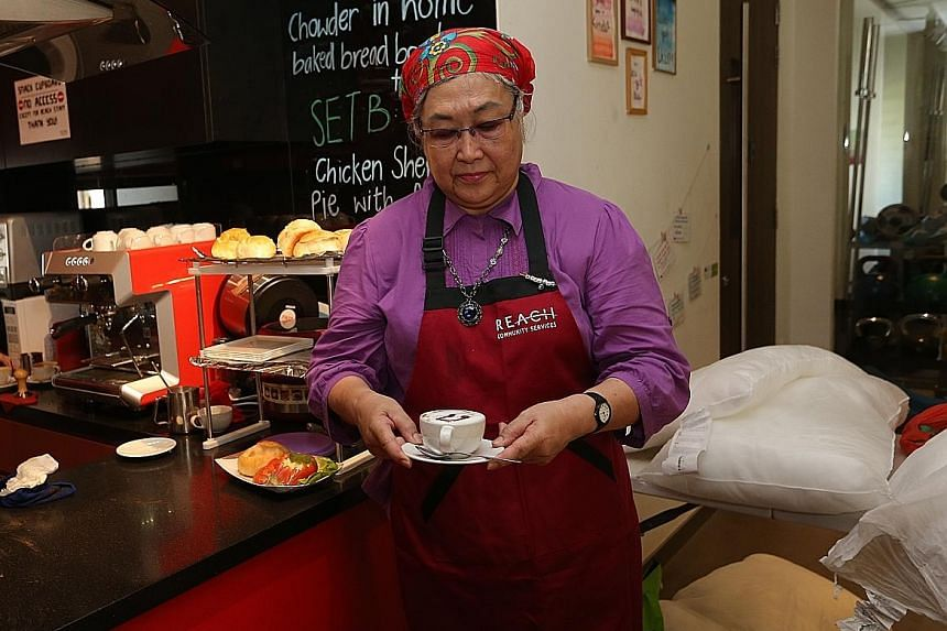 """Madam Mary Sim, 68, volunteers once a month at the Reach Community Cafe. She says volunteering """"makes me glad""""."""