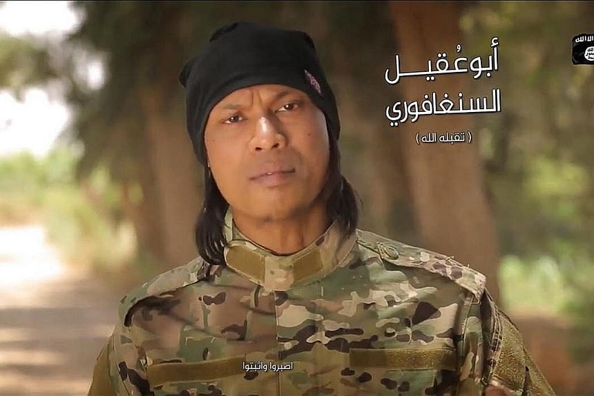 """Singaporean Megat Shahdan Abdul Samad, identified as """"Abu Uqayl the Singaporean"""" in Arabic words, surfaced in a propaganda video believed to have been posted last Friday, dressed in military fatigues. He was also seen in an ISIS clip in September."""