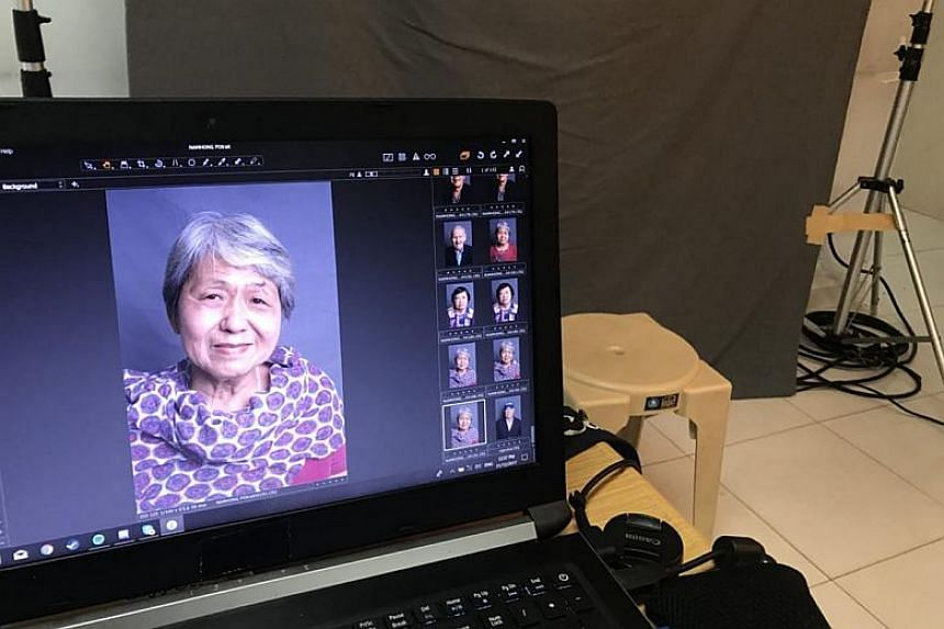 Madam Ang Cheng Boey, 72, with pink lipstick on and a pretty scarf around her neck.