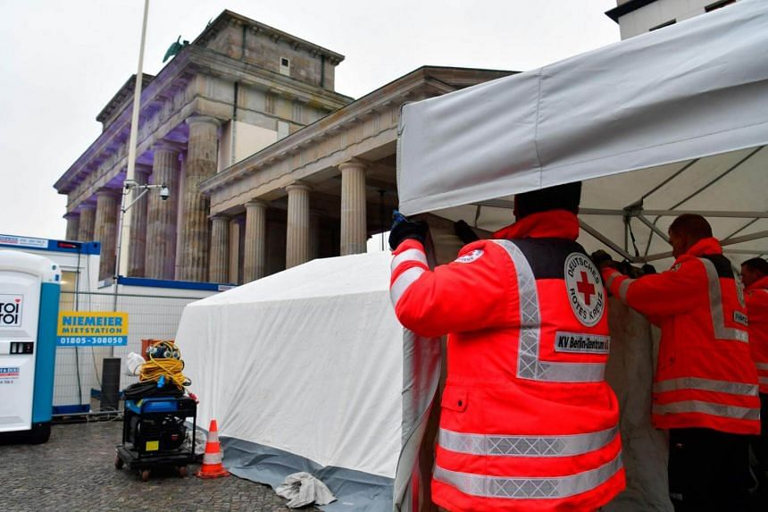 Red Cross workers set up an emergency tent in front of Berlin's landmark Brandenburg Gate, on Dec 30, 2017.