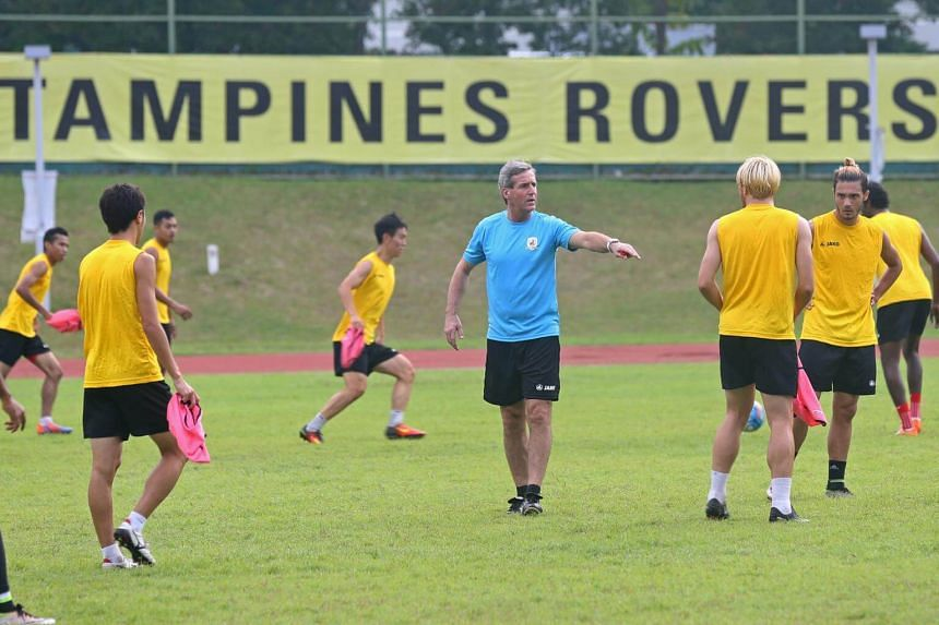 Tampines Rovers coach Juergen Raab (in blue) instructing his players during a training session with the team at Jurong West Stadium on Feb 2, 2017.