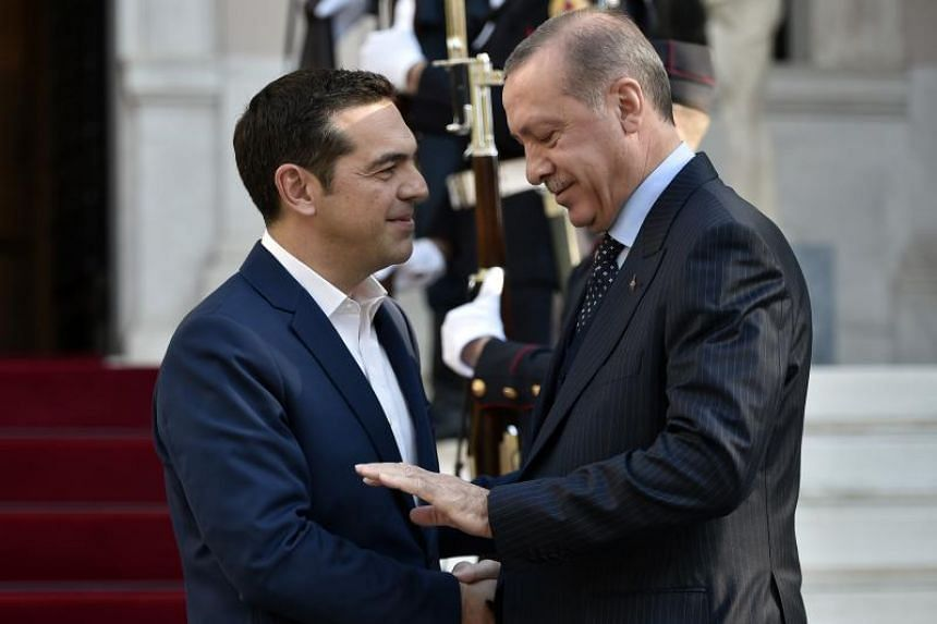 The ruling is an embarrassment to Recep Tayyip Erdogan (right), who asked for the officers to be extradited during a meeting with Greek Prime Minister Alexis Tsipras (left) in December.