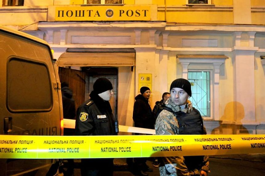Ukrainian policemen are seen after storming the office of the Ukrposhta postal service in northeastern Ukrainian city of Kharkiv on Dec 30, 2017