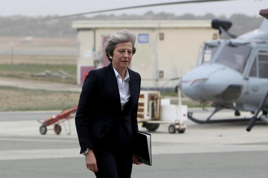 British Prime Minister Theresa May visiting RAF Akrotiri, one of two military bases Britain maintains on the east Mediterranean island of Cyprus, on Dec 22, 2017.