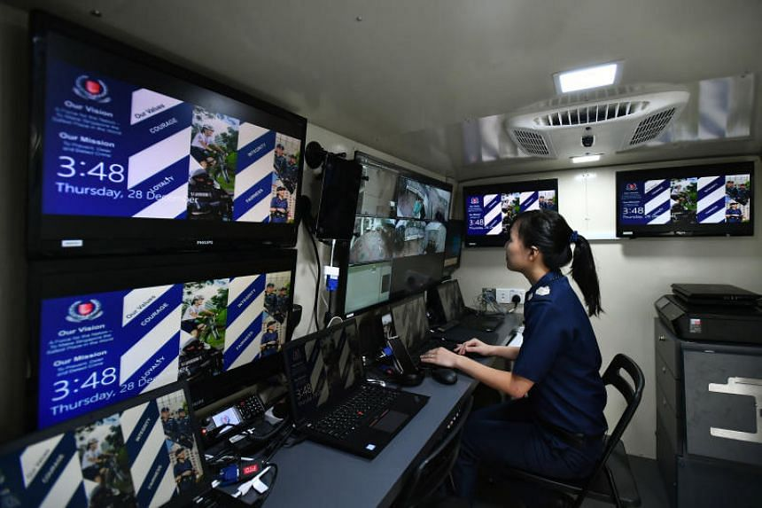Senior Staff Sergeant Yu Wan Ling is monitoring CCTV footage inside the Division Command Vehicle at Tanglin Police Division on Dec 28, 2017.
