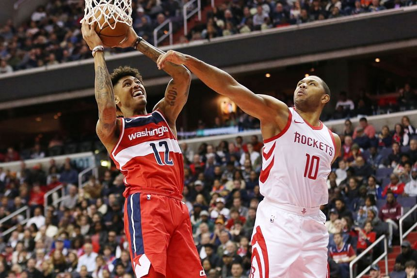 Washington Wizards forward Kelly Oubre Jr, who scored 10 of his 21 points in the fourth quarter, going up for a dunk despite the attention of Houston Rockets guard Eric Gordon. The Wizards handed the Houston Rockets their fifth consecutive National B
