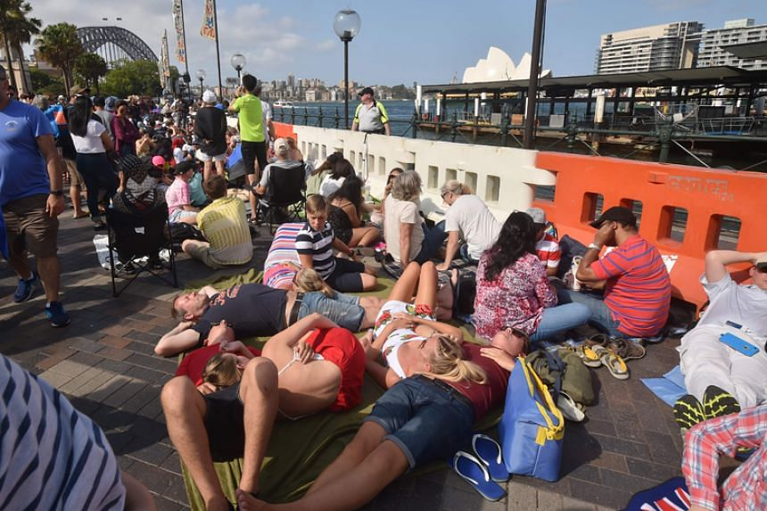 Crowds gather at Circular Quay ahead of the New Year's Eve fireworks display in Sydney on Dec 31, 2017.