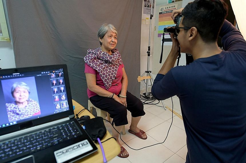 Madam Ang Cheng Boey having her portrait taken at Nam Hong Welfare Service Society. The photos of the elderly beneficiaries will be printed and given to the seniors, who can use them in any way they like, including for their funeral service.