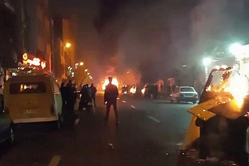 Protests in Teheran (top and above) are among the wave of anti-government demonstrations in several cities in Iran.