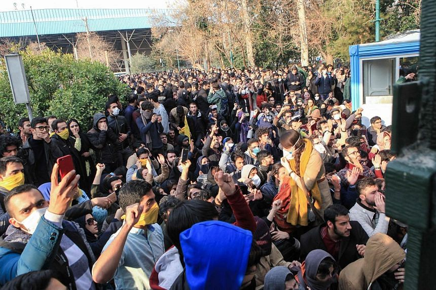 Iranian students protesting at the University of Teheran on Saturday over the country's economic problems. The protests in various parts of the country have included chants and slogans against Supreme Leader Ayatollah Ali Khamenei and the clerical le