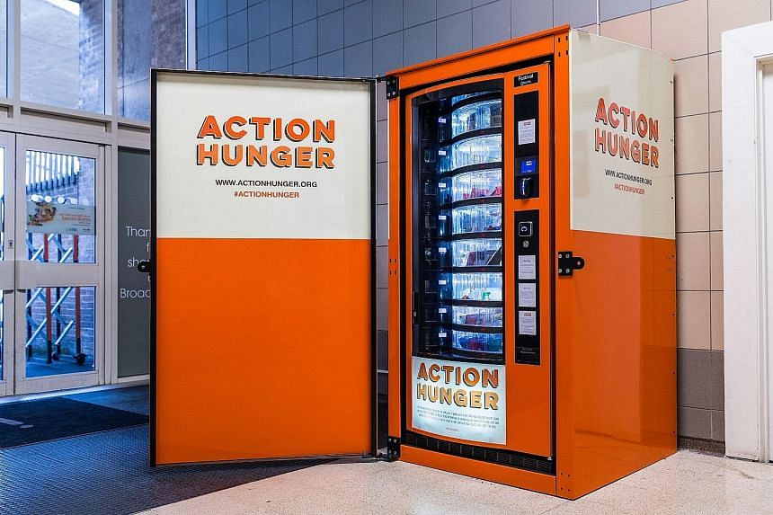 An Action Hunger vending machine stocked with free food and clothing for the homeless in Nottingham, England. The charity hopes to expand across Britain as well as in Europe and the US.