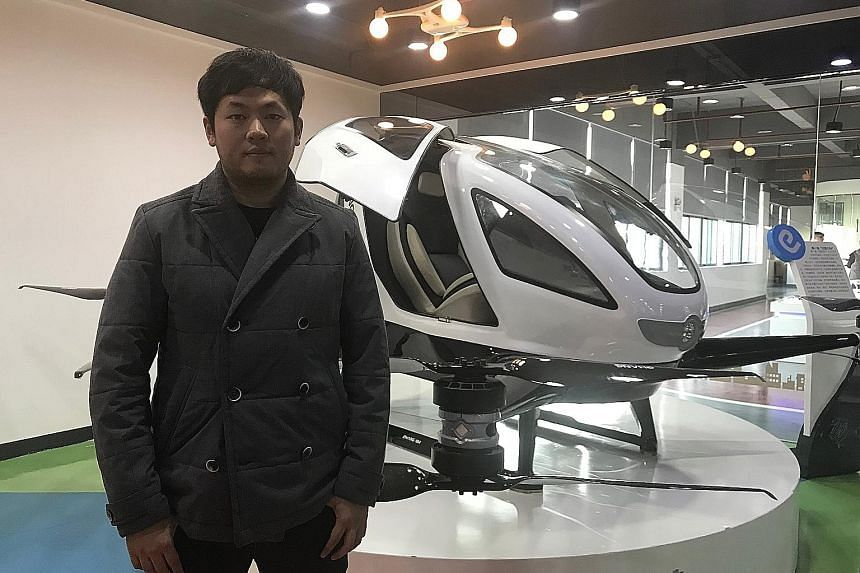 Mr Derrick Xiong with the Ehang 184, which has four battery-powered propellers and is equipped with fully automated navigation. It can fly for 20 to 30 minutes at a height of 300m to 500m.