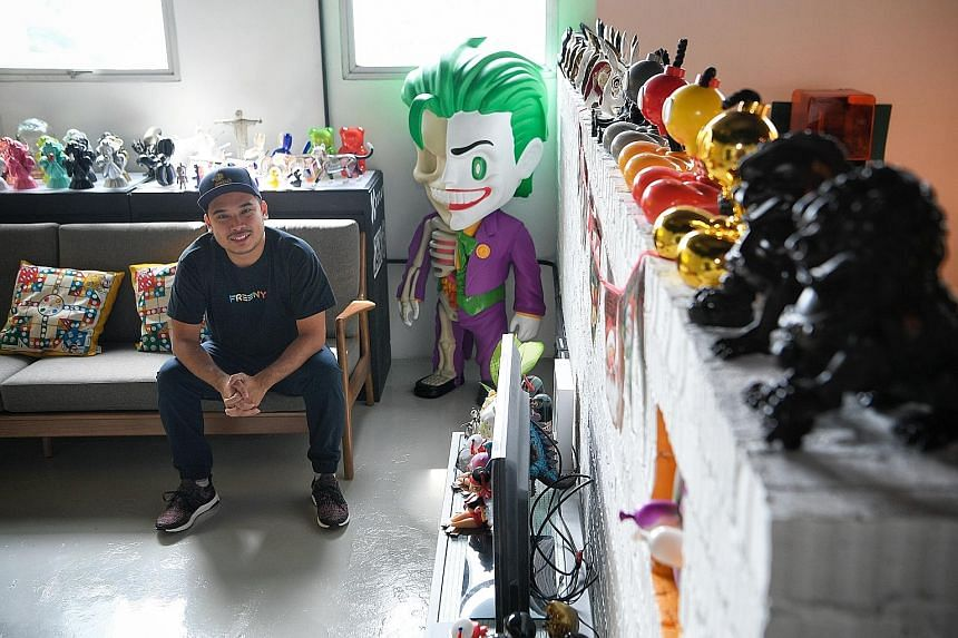 Mr Jackson Aw, 28, founder of local designer toy company Mighty Jaxx, at his office in Prosper House, Geylang, next to an XXRAY figure of the Joker. The company, which now works with brands like Warner Bros and is projected to hit $5 million in reven