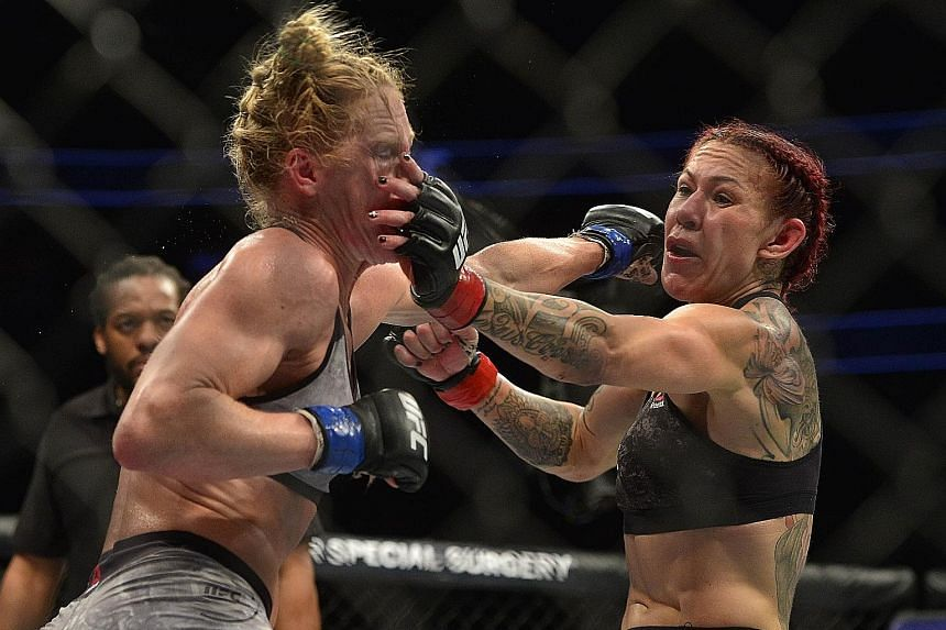 Cris Cyborg landing a hit against American Holly Holm during UFC 219 at the T-Mobile Arena in Las Vegas on Saturday. The 32-year-old Brazilian retained her Ultimate Fighting Championship (UFC) featherweight title with a unanimous-decision victory. Th