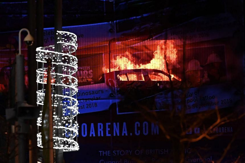 Cars burn during a blaze engulfing vehicles parked at a multi-storey car park near the Echo Arena in Liverpool, England, on Dec 31.