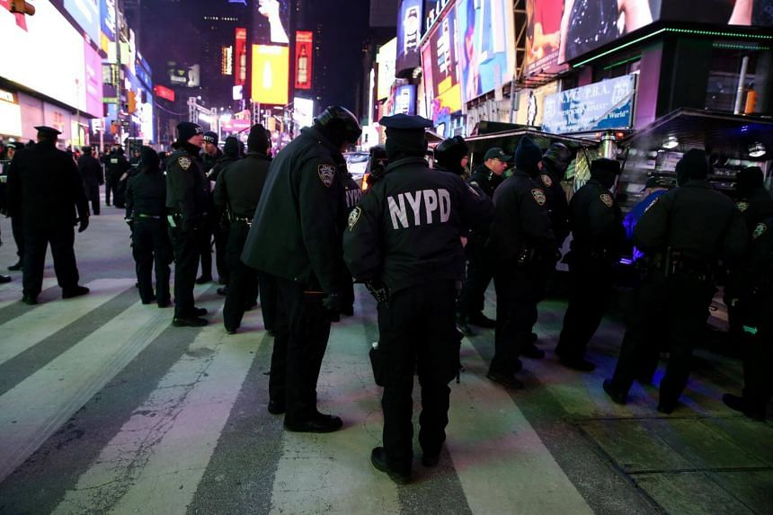 Police officers stand in Times Square ahead of the New Year's Eve celebrations in Manhattan, New York.