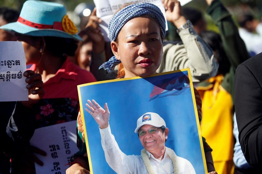 Supporters of Kem Sokha, head of the banned opposition Cambodia National Rescue Party, stand outside the Appeal Court during a bail hearing for the jailed opposition leader in Phnom Penh on Sept 26, 2017.