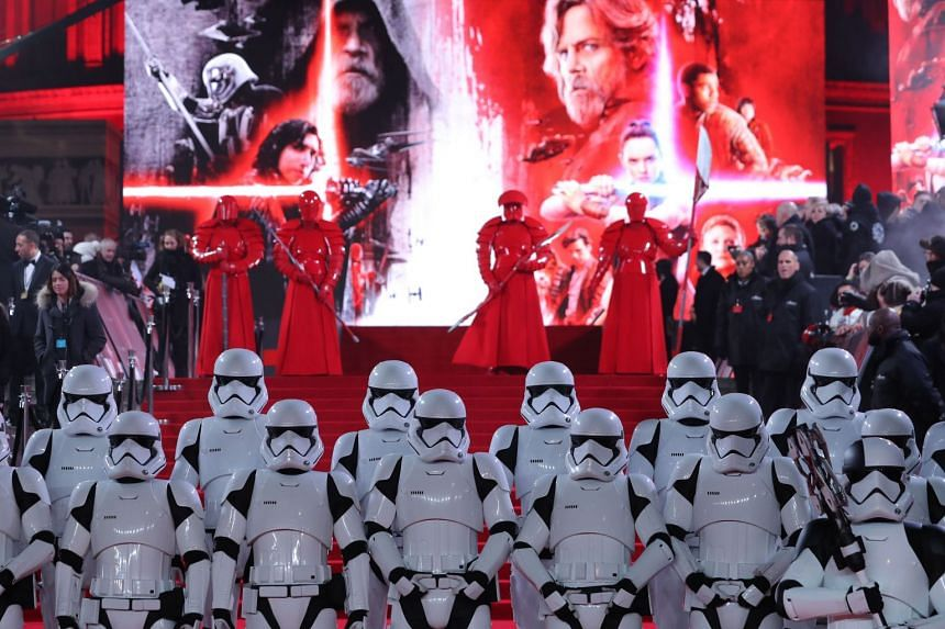 Stormtrooopers and Praetorian guards posing on the red carpet in London for the European premiere of Star Wars: The Last Jedi.