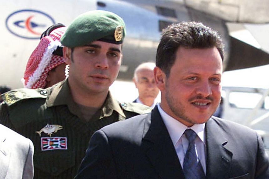 Jordan's King Abdullah (right) had relieved his brothers Prince Ali (left) and Prince Faisal from top army posts in a major shakeup on Dec 28, 2017.