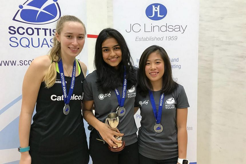 A happy Sneha Sivakumar after beating compatriot Au Yeong Wai Yhann to win the Scottish Junior Open Girls' Under-19 title, with England's Charlotte Jagger third.
