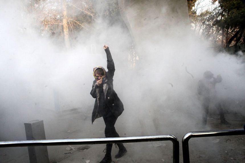 Iranian students clash with riot police during an anti-government protests around the Teheran University in Iran, on Dec 30, 2017.
