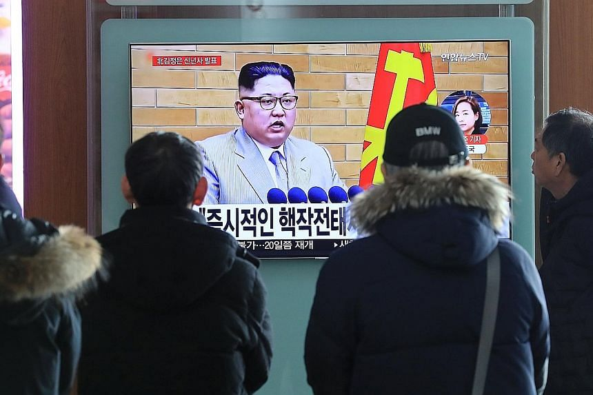 Seoul residents watching a report on Mr Kim Jong Un's New Year's Day speech. He said he will consider sending a delegation to the Winter Olympic Games to be held in South Korea next month.