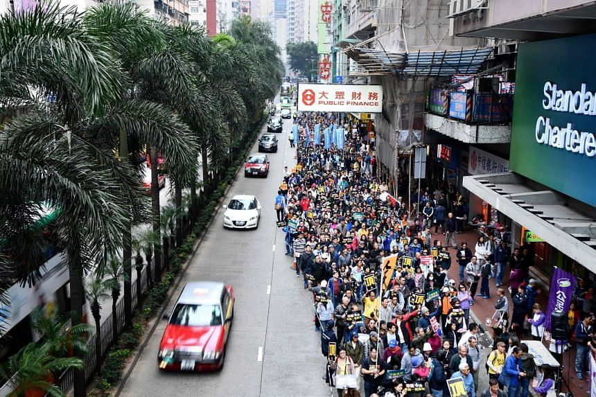 """Hong Kongers protesting against """"suppression"""" by Beijing yesterday, days after the Chinese authorities ruled that part of a city rail station would come under mainland law."""