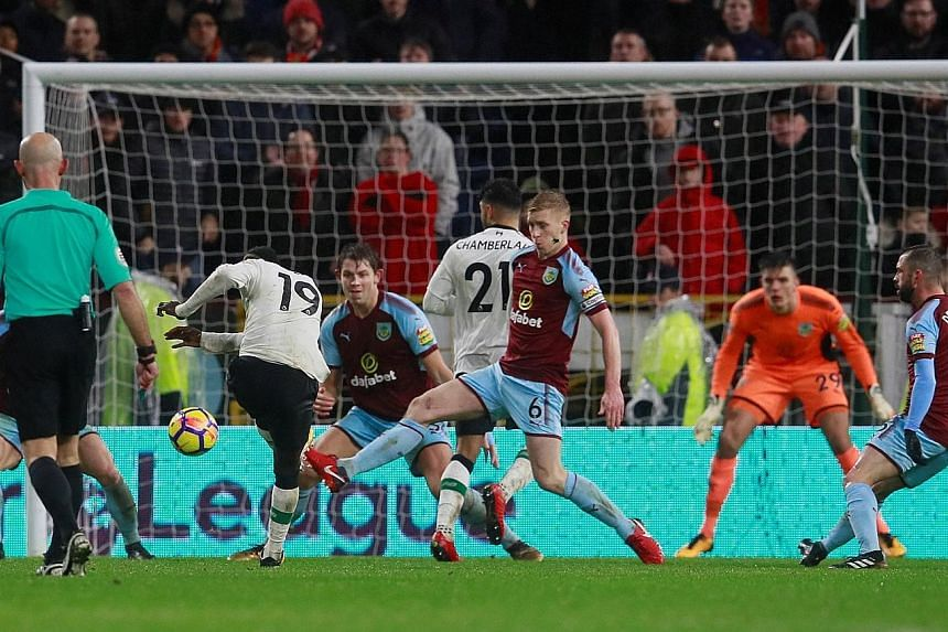 Sadio Mane (No. 19) hitting a rising shot that left Burnley goalkeeper Nick Pope with no chance of keeping out the game's opening goal. Liverpool conceded a late equaliser, but then hit back through Ragnar Klavan to win 2-1.