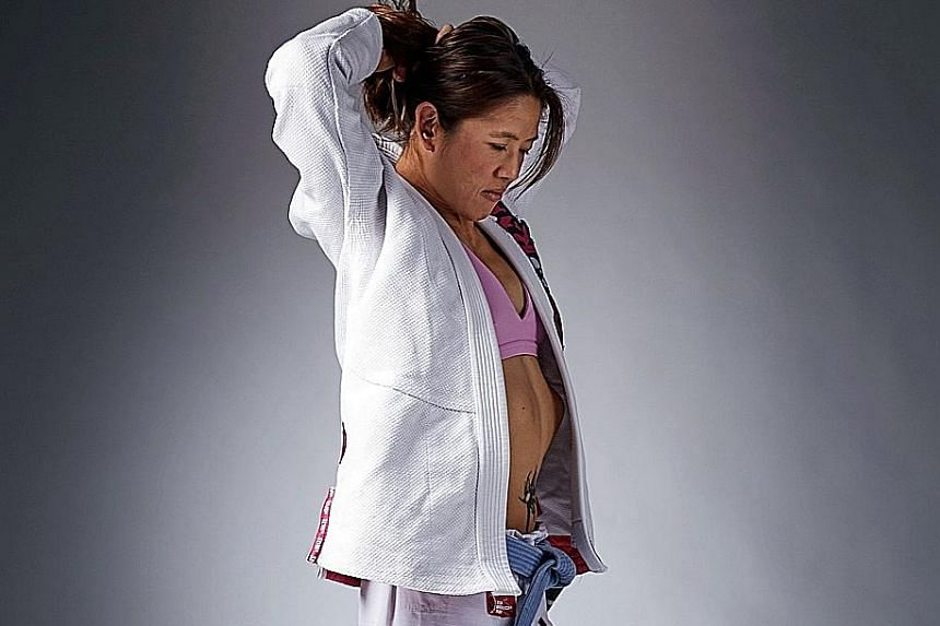Former national swimmer May Ooi is targeting a gold medal tilt at the Aug 18-Sept 2 Asian Games in Indonesia, having successfully made the transition to mixed martial arts.