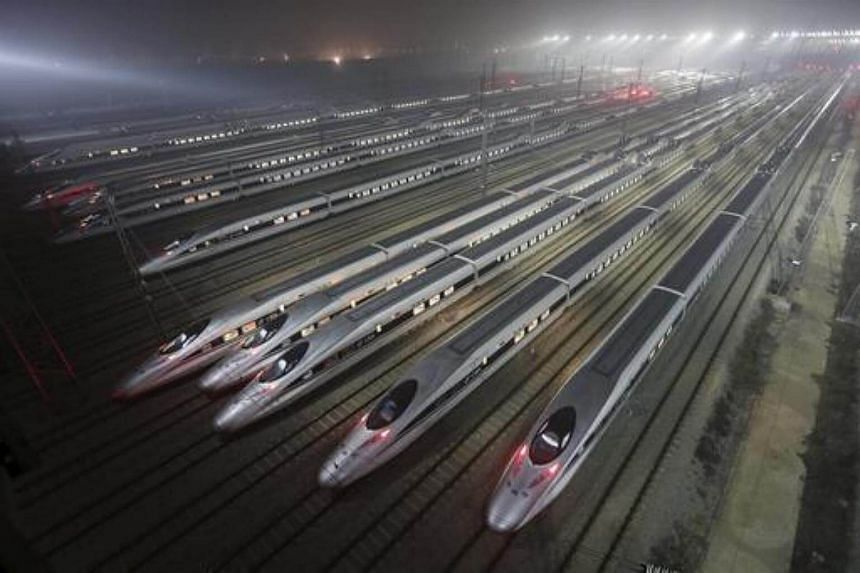 Bullet trains at a maintenance base in Wuhan, Hubei province.