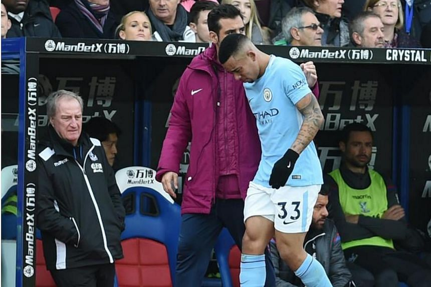 Manchester City's Gabriel Jesus limps off injured during the Premier League match Crystal Palace vs Manchester City at Selhurst Park in London on Dec 31, 2017.