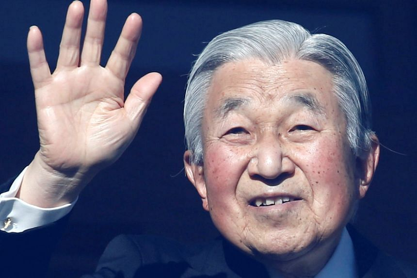 Japan's Emperor Akihito waves to well-wishers during a public appearance for New Year celebrations at the Imperial Palace in Tokyo.