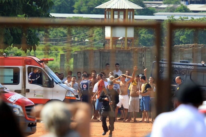 A group of inmates guarded by the authorities at a prison in the metropolitan region of Goiania.