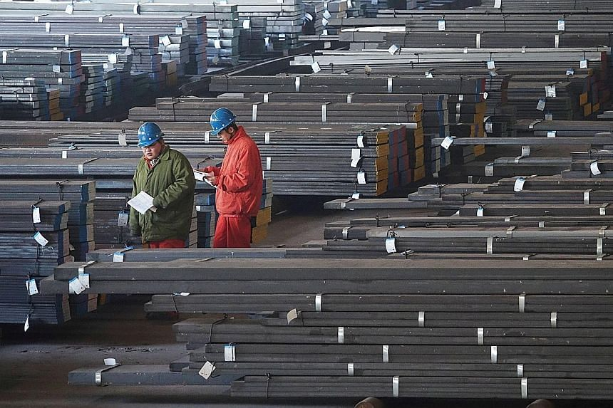 Workers checking steel bars at a factory in Dalian, Liaoning province. In China, manufacturing growth unexpectedly picked up to a four-month high in December amid a surge in new orders, suggesting continued strength in global trade.
