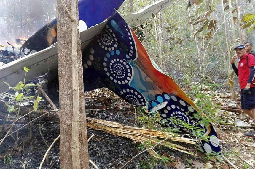 The remains of the small plane that crashed in the province of Guanacaste, Costa Rica, on Sunday. The crash killed all 10 American tourists on board and two local crew members. Strong winds may have been a factor, say officials and witnesses.