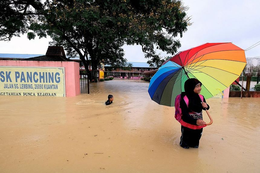 Eleven schools in Malaysia's eastern state of Pahang were forced to close yesterday - the first day of the new school year - because floodwaters had inundated their grounds or cut off their access roads.