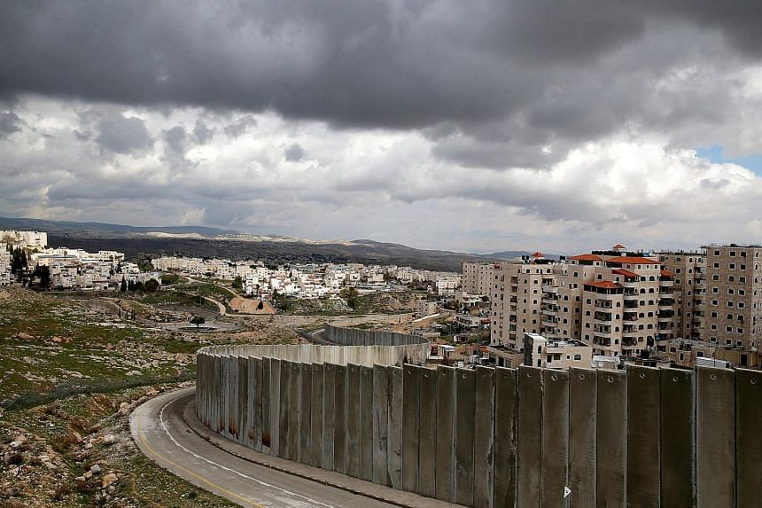 A view of the Israeli barrier running between the East Jerusalem refugee camp of Shuafat (right) and Pisgat Zeev, both located in an area Israel annexed to Jerusalem after capturing it in the 1967 Middle East war.