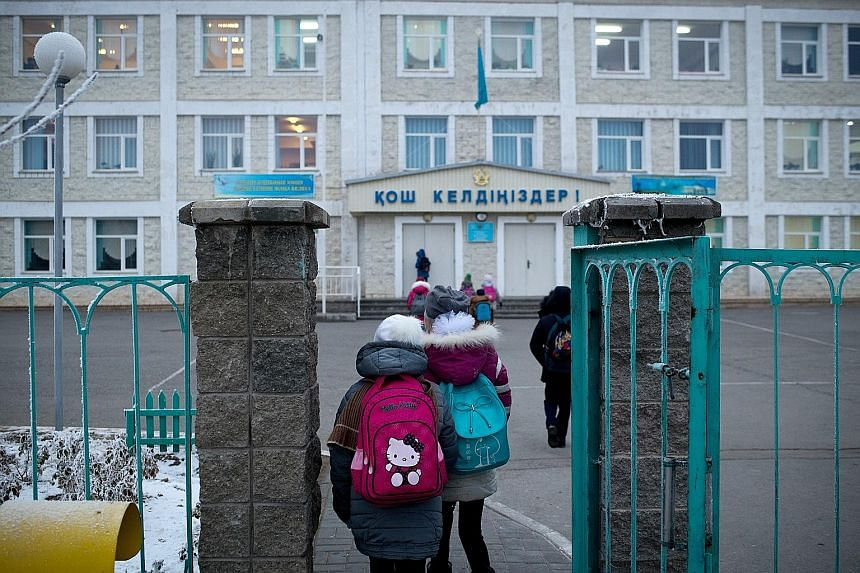 Children heading to school in Nurkent, a town near the Khorgos Gateway in Kazakhstan. The town was built to house workers and officials working on the gateway, part of China's Belt and Road Initiative.