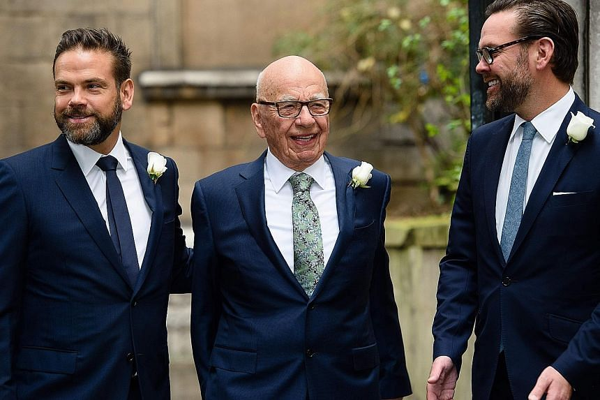 Mr Rupert Murdoch wants his elder son Lachlan (left, also seen with younger brother James) to be chief executive officer of New Fox.