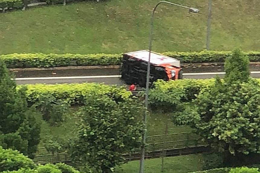 This lorry overturned and blocked the slip road leading into the Tampines Expressway. The accident happened at 2.38pm, police told The Straits Times. There was no report of anyone being injured.