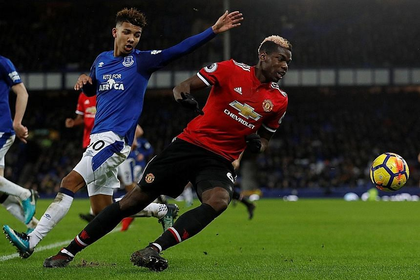Manchester United midfielder Paul Pogba escaping the attention of Everton centre-back Mason Holgate. The France international was instrumental in the 2-0 away win on Monday.