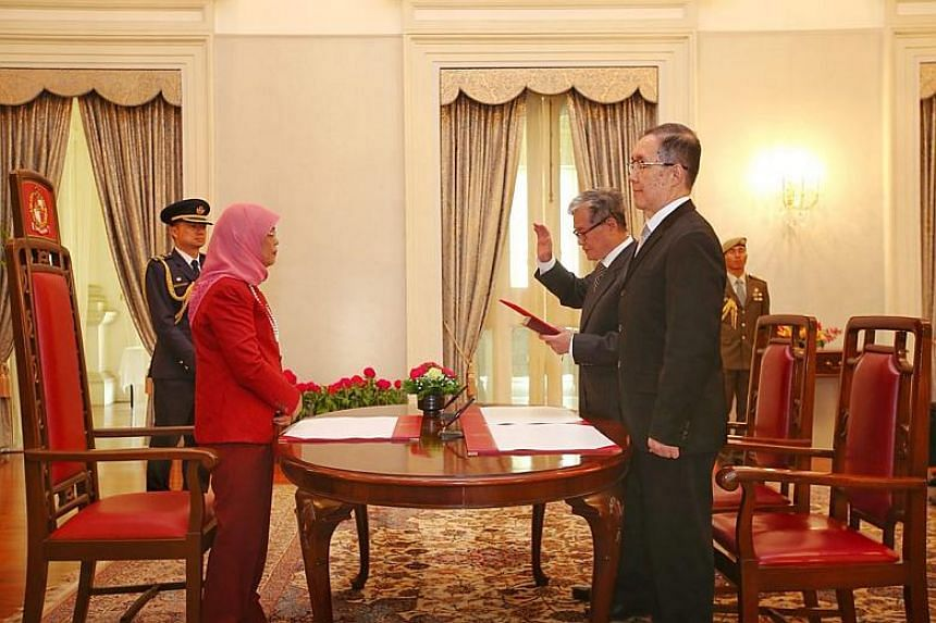 President Halimah Yacob officiating the swearing-in ceremony and appointment ceremony of Mr Goh Joon Seng (centre) to the Council of Presidential Advisers on Jan 3, 2018. Justice Tay Yong Kwang (right) was the witness.
