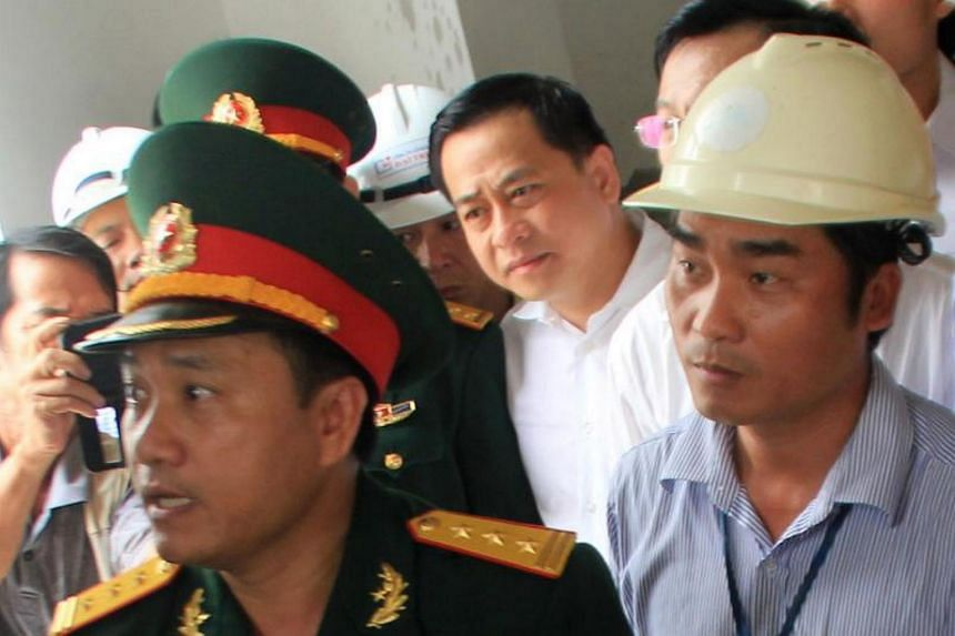 Mr Phan Van Anh Vu (pictured, centre) is facing issues over holding two different passports, his lawyer said on Jan 3, 2018.