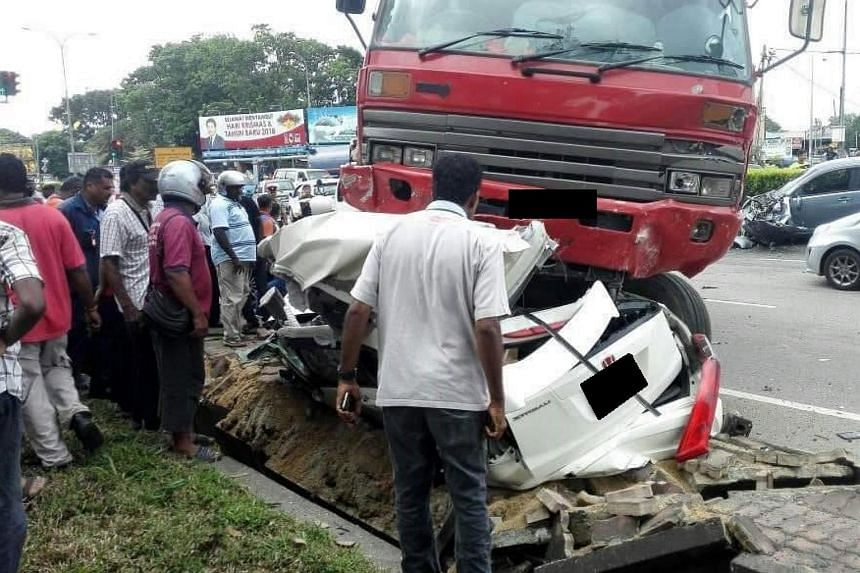 Four Singaporeans were killed in an accident at Jalan Lukut Sepang in Port Dickson on Jan 3, 2018.