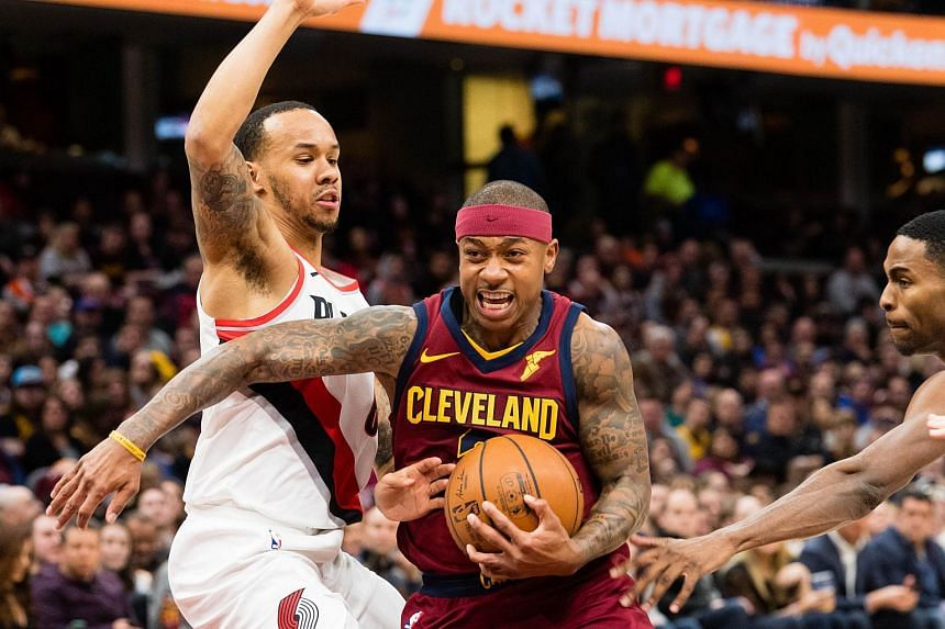 Cleveland Cavaliers guard Isaiah Thomas (centre) driving to the basket against Portland Trail Blazers guard Shabazz Napier (left) during their NBA match on Jan 2, 2018.