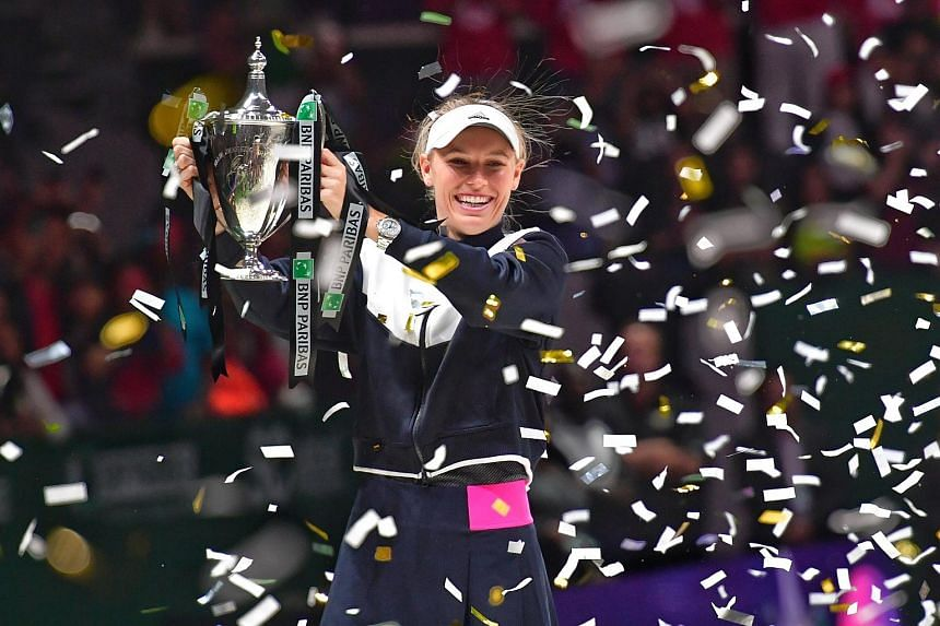Caroline Wozniacki celebrating with the Billie Jean King trophy after beating Venus Williams in the WTA Finals on Oct 29, 2017.
