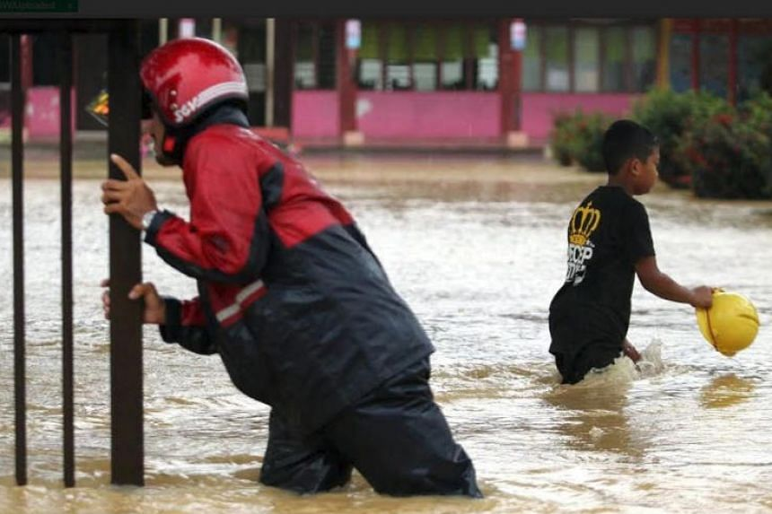 Heavy rains and floods forced the closure of schools in Johor, Pahang and Sabah, and students were sent home.