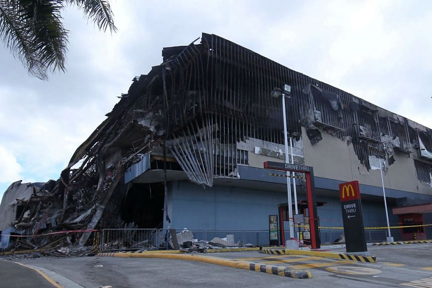 Philippine Economic Zone Authority (PEZA) has suspended the registration of the New City Commercial Center (NCCC) and American firm Research Now SSI in Davao City for failing to meet certain safety requirements since 2013.