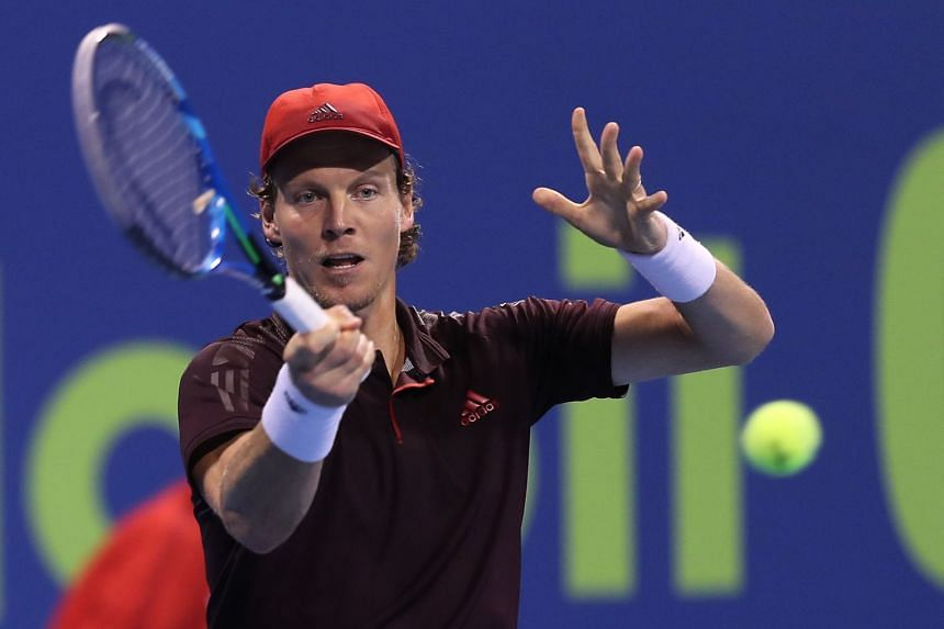 Berdych returns the ball to Jan-Lennard Struff of Germany during the first round of the ATP Qatar Open.