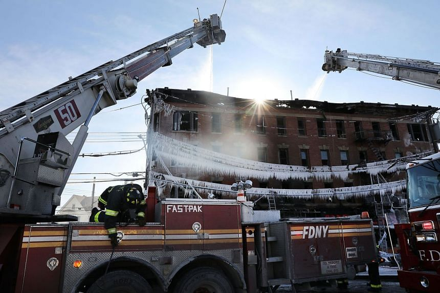 Firefighters battle a 7-alarm fire in the Bronx borough of New York City on Jan 2, 2018.